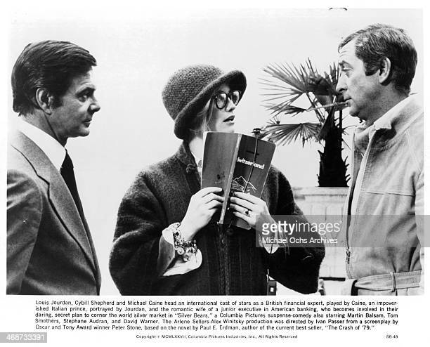 Actor Louis Jourdan actress Cybill Shepherd and Michael Caine on set the movie Silver Bears circa 1977