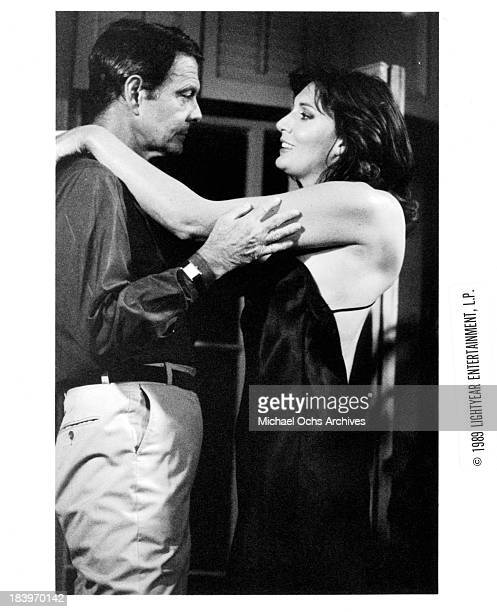 Actor Louis Jourdan and actress Sarah Douglas on set for the movie The Return of Swamp Thing in 1989