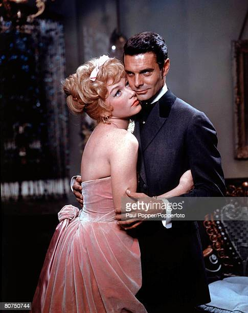 1960 Actor Louis Jourdan and actress Shirley MacLaine embrace during a scene in the film Can Can