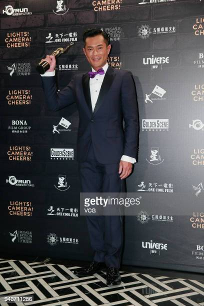 Actor Louis Koo poses with the Best Actor award at the after party of the 37th Hong Kong Film Awards ceremony on April 15 2018 in Hong Kong China