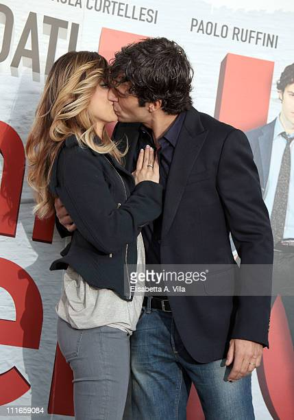 Actor Luca Argentero and his wife actress Myriam Catania kiss during the C'E' Chi Dice No photocall at The Space Moderno on April 5 2011 in Rome Italy