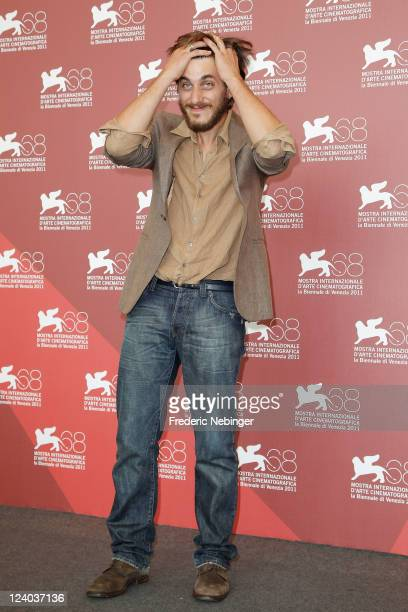 """Actor Luca Marinelli poses at the """"L'ultimo Terrestre"""" photocall at the Palazzo del Cinema during the 68th Venice Film Festival on September 8, 2011..."""
