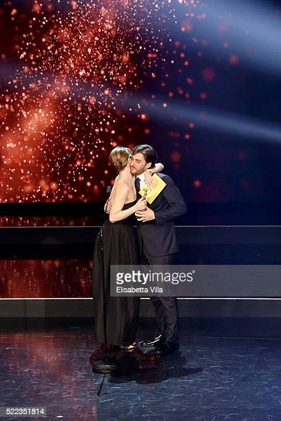 Actor Luca Marinelli receives the Best Supporting Actor award from Paola Cortellesi during the 60 David Di Donatello awards ceremony on April 18 2016...
