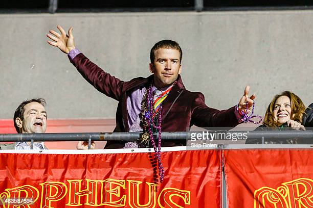 Actor Lucas Black of the CBS drama NCIS NEW ORLEANS watches the Krewe of Bacchus parade from the Orpheus grand stand during Mardi Gras enter caption...