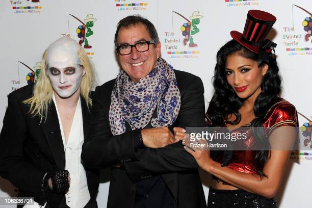 Actor Lucas Grabeel director Kenny Ortega and singer Nicole Scherzinger arrive at The Rocky Horror Picture Show 35th anniversary to benefit The...