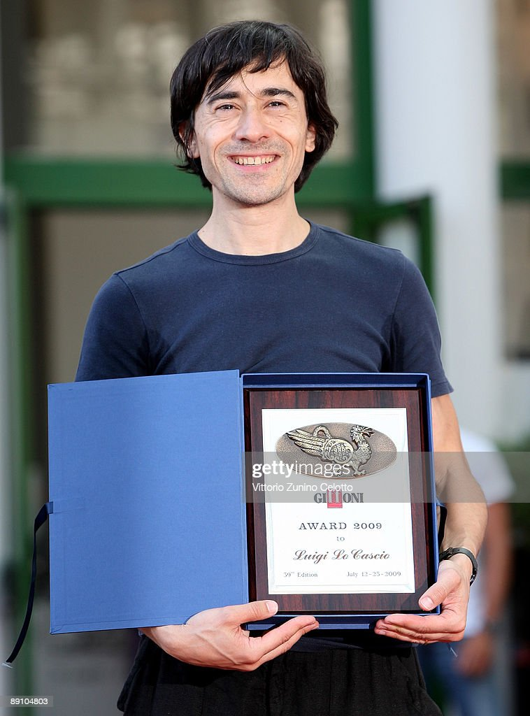 Actor Luigi Lo Cascio poses with the Giffoni Award during the 2009 Giffoni Experience on July 19, 2009 in Salerno, Italy.
