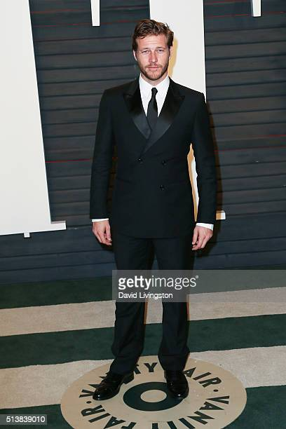 Actor Luke Bracey arrives at the 2016 Vanity Fair Oscar Party Hosted by Graydon Carter at the Wallis Annenberg Center for the Performing Arts on...
