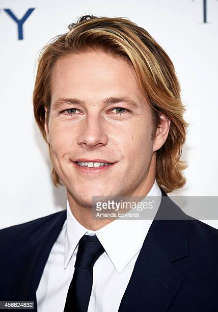 Actor Luke Bracey arrives at the Los Angeles premiere of The Best Of Me at the Regal Cinemas LA Live on October 7 2014 in Los Angeles California