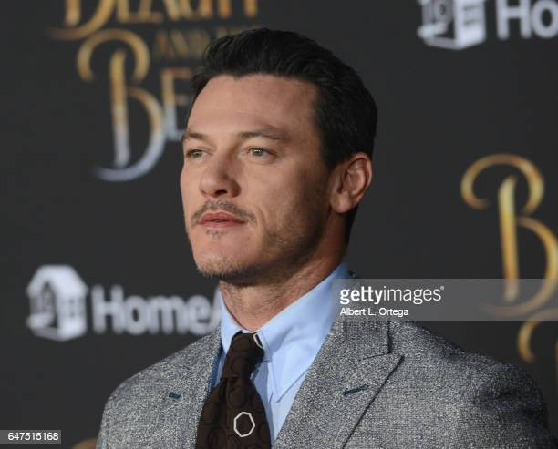 Actor Luke Evans arrives for the Premiere Of Disney's 'Beauty And The Beast' held at El Capitan Theatre on March 2 2017 in Los Angeles California