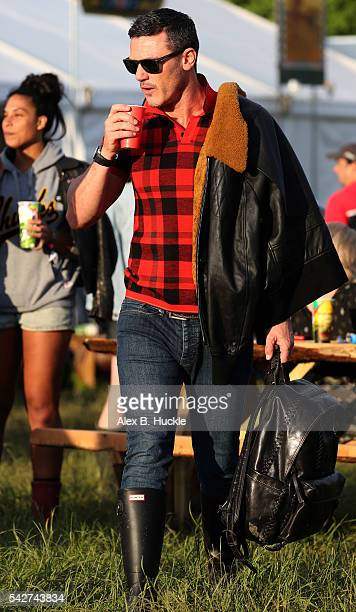 Actor Luke Evans attends the Glastonbury Festival at Worthy Farm Pilton on June 24 2016 in Glastonbury England