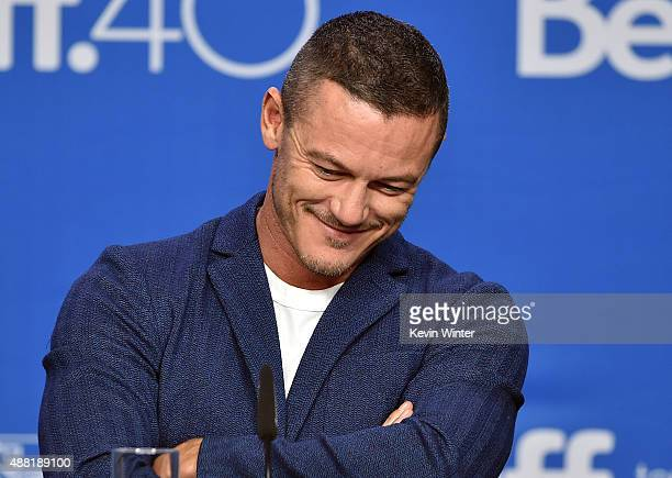 Actor Luke Evans speaks onstage during the HighRise press conference at the 2015 Toronto International Film Festival at TIFF Bell Lightbox on...