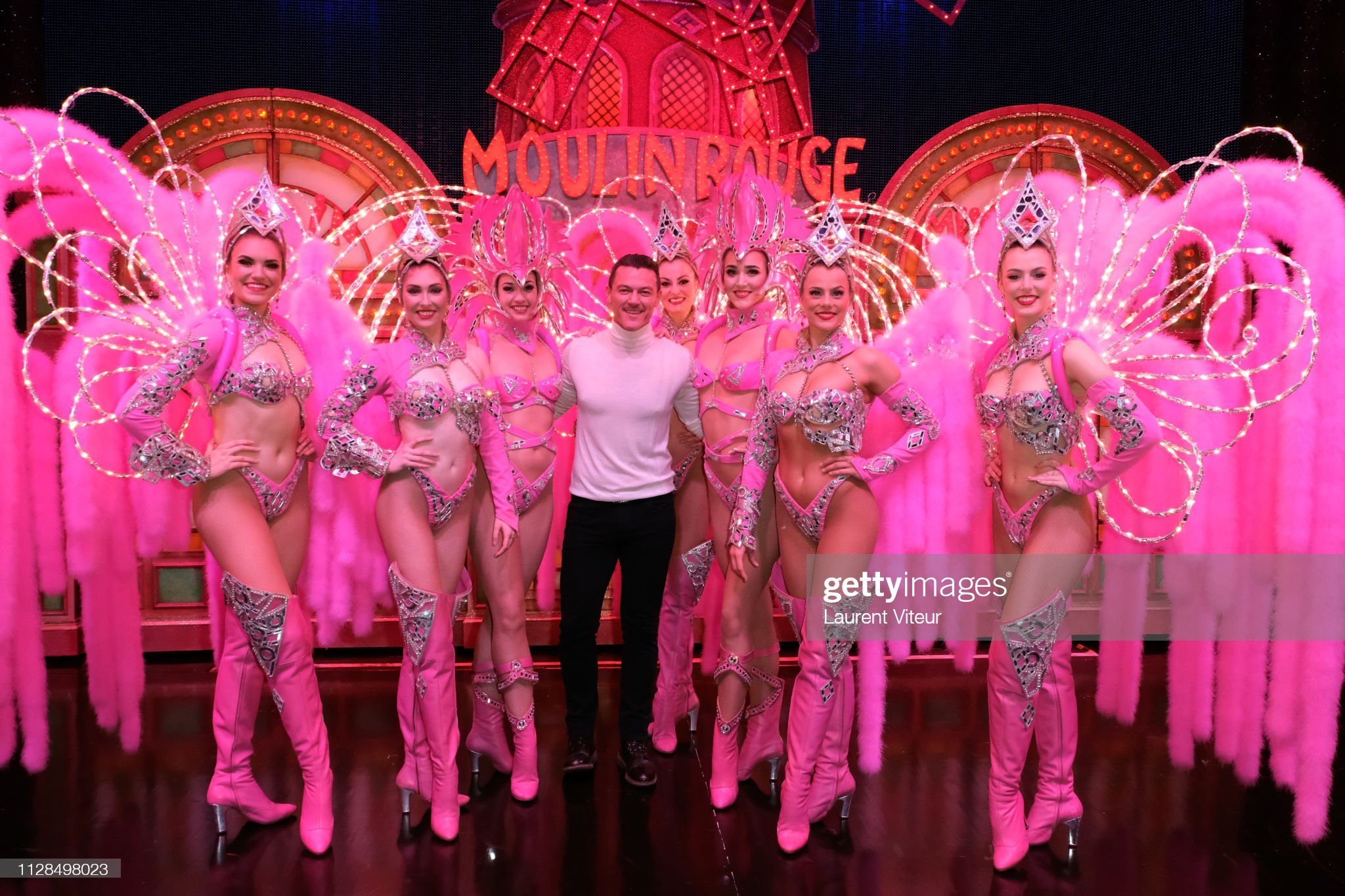 actor-luke-evans-with-the-dancers-of-moulin-rouge-attends-feerie-at-picture-id1128498023