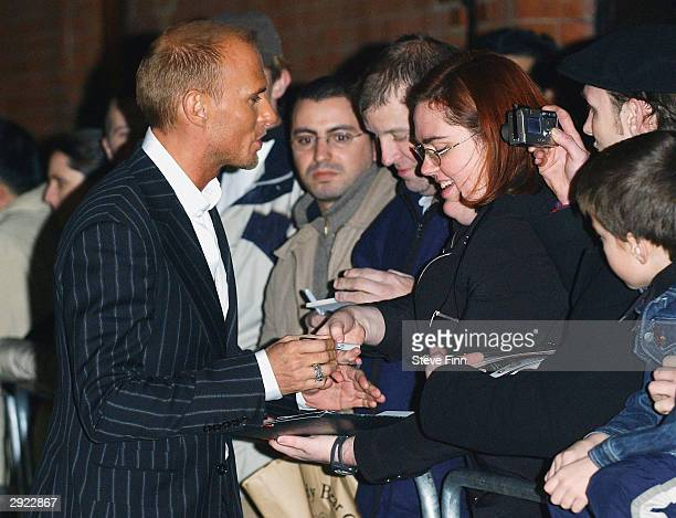 Actor Luke Goss signs an autograph for a fan at the UK Premiere of Charlie at the Warner Village Cinema West End on February 2 2004 in London Charlie...
