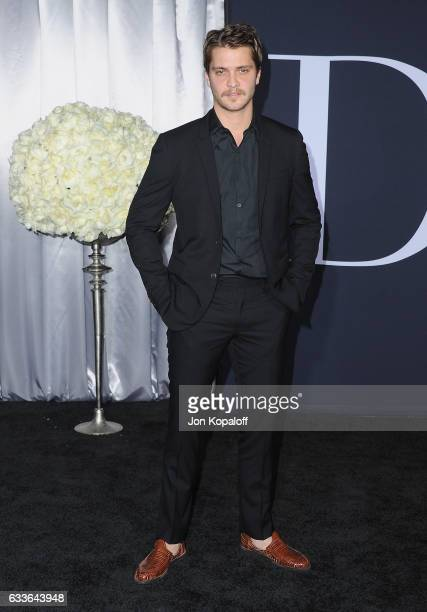 Actor Luke Grimes arrives at the Los Angeles premiere Fifty Shades Darker at The Theatre at Ace Hotel on February 2 2017 in Los Angeles California