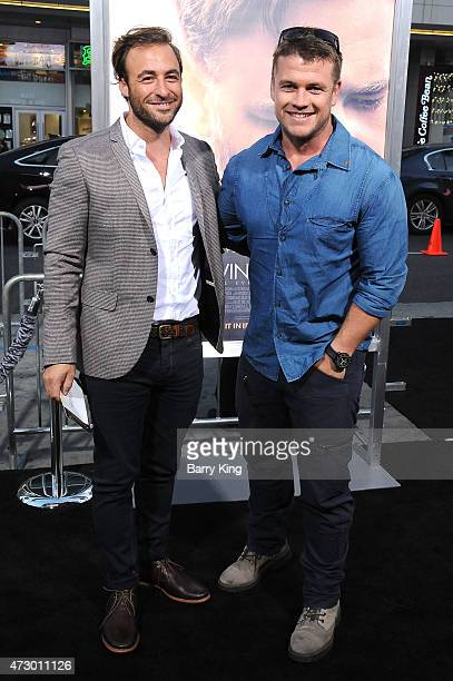 Actor Luke Hemsworth and Mark Chaz attend the premiere of 'The Water Diviner' at TCL Chinese Theatre IMAX on April 16 2015 in Hollywood California