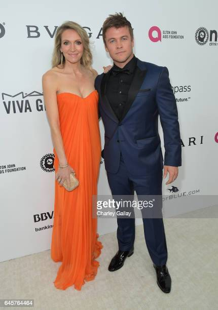 Actor Luke Hemsworth and Samantha Hemsworth attend the 25th Annual Elton John AIDS Foundation's Academy Awards Viewing Party with cocktails by Clase...
