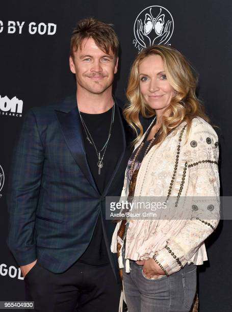 Actor Luke Hemsworth and wife Samantha Hemsworth arrive at Teton Gravity Research's 'Andy Irons: Kissed by God' World Premiere at Regency Village...