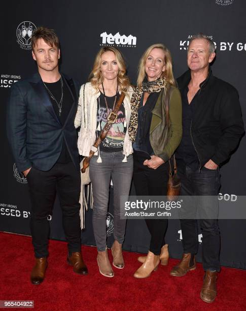 Actor Luke Hemsworth, wife Samantha Hemsworth and guest arrive at Teton Gravity Research's 'Andy Irons: Kissed by God' World Premiere at Regency...