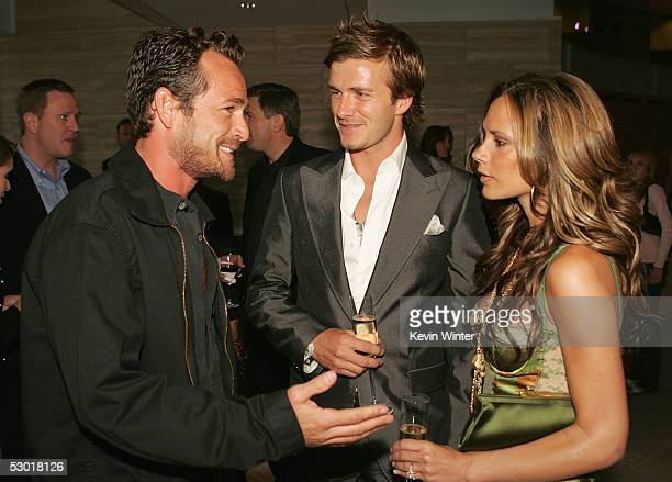 Actor Luke Perry England and Real Madrid football player David Beckham and wife Victoria talk at The David Beckham Academy launch party at Creative...
