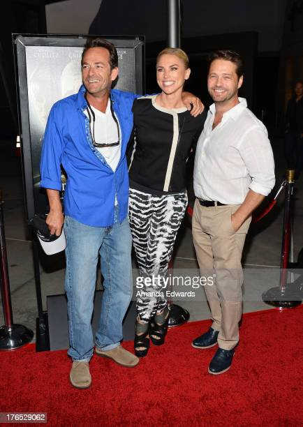 Actor Luke Perry Naomi LowdePriestley and actor Jason Priestley arrive at the premiere of Dark Tourist at ArcLight Hollywood on August 14 2013 in...