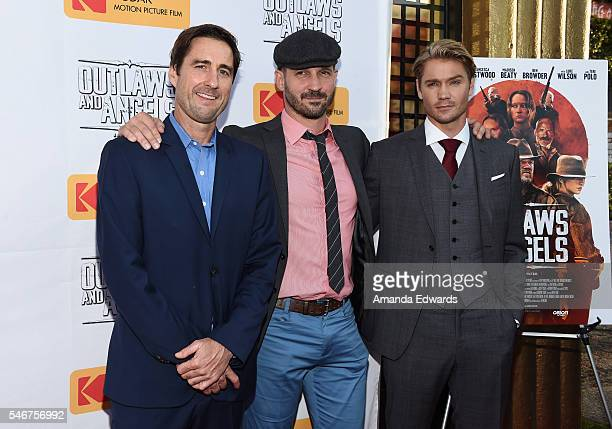 Actor Luke Wilson director and writer JT Mollner and actor Chad Michael Murray arrive at the premiere of Momentum Pictures' Outlaws and Angels at the...