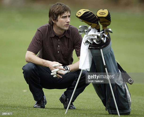 Actor Luke Wilson waits to play on the 11th hole during the second round of the Bob Hope Chrysler Classic at La Quinta Country Club on January 22...