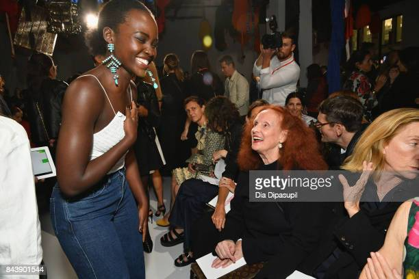 Actor Lupita Nyong'o and Creative Director at Large of Vogue Magazine Grace Coddington attend the Calvin Klein Collection fashion show during New...