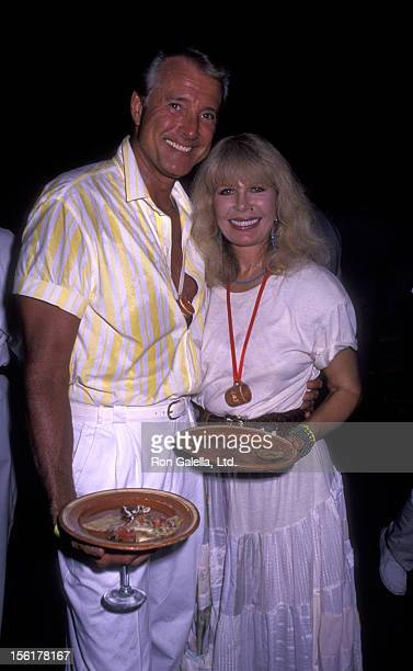 Actor Lyle Waggoner and actress Loretta Switt attend Las Hadas Celebrity Sports Invitational on May 11 1990 in Manzillo Mexico