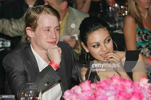 Actor Macaulay Culkin and actress Mila Kunis attend the launch of the uBid for Hurricane Relief charity auction and benefit at the Empire Ballroom...