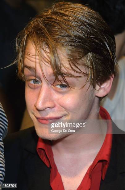 Actor Macaulay Culkin takes a break at a rainy openning night of The Seagull August 12 2001 at the Delacorte Theatre in New York City''s Central Park