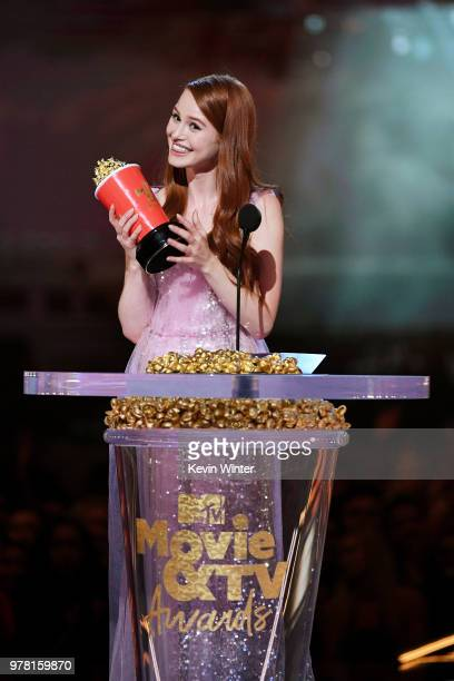 Actor Madelaine Petsch accepts the Scene Stealer award for 'Riverdale' onstage during the 2018 MTV Movie And TV Awards at Barker Hangar on June 16...