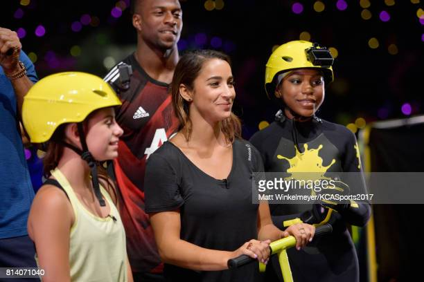 Actor Madisyn Shipman Olympic gymnast Aly Raisman and actor Riele Downs participate in a competition during Nickelodeon Kids' Choice Sports Awards...