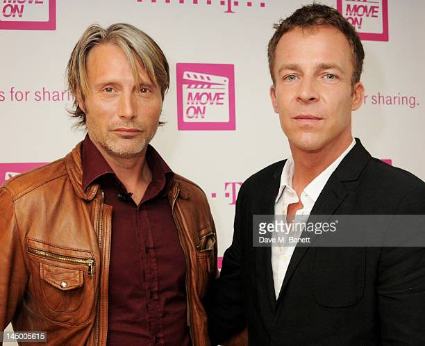 Actor Mads Mikkelsen and director Asger Leth attend as Deutsche Telekom and Asger Leth launch 'Move On' during the 65th Cannes Film Festival aboard...