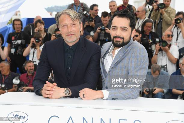 Actor Mads Mikkelsen and director Joe Penna attend the photocall for 'Arctic' during the 71st annual Cannes Film Festival at Palais des Festivals on...