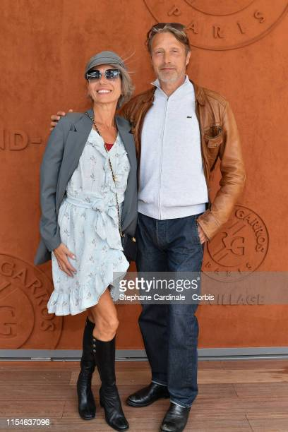 Actor Mads Mikkelsen and his wife Hanne Jacobsen attend the 2019 French Tennis Open Day Fourteen at Roland Garros on June 08 2019 in Paris France
