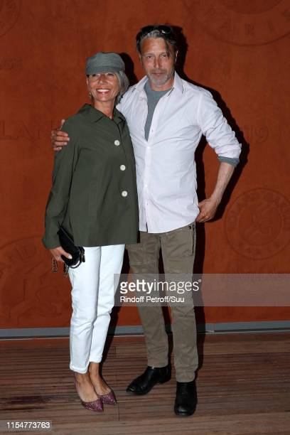 Actor Mads Mikkelsen and his wife Hanne Jacobsen attend the 2019 French Tennis Open Day Fifteen at Roland Garros on June 09 2019 in Paris France