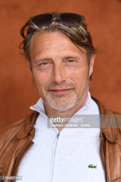 Actor Mads Mikkelsen attends the 2019 French Tennis Open - Day Fourteen at Roland Garros on June 08, 2019 in Paris, France.