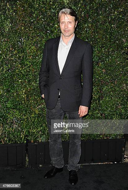 Actor Mads Mikkelsen attends the Chanel and Charles Finch preOscar dinner at Madeo Restaurant on March 1 2014 in Los Angeles California
