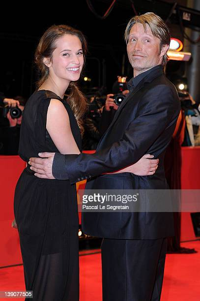 Actor Mads Mikkelson and actress Alicia Vikander attend the En Kongelig Affaere Premiere during day eight of the 62nd Berlin International Film...