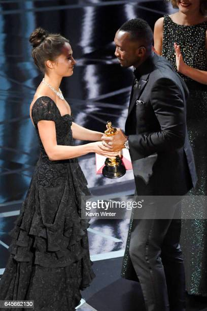 Actor Mahershala Ali accepts Best Supporting Actor for 'Moonlight' from actor Alicia Vikander onstage during the 89th Annual Academy Awards at...