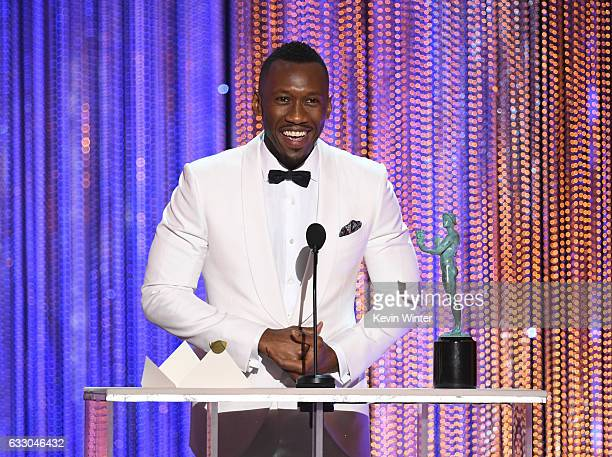 Actor Mahershala Ali accepts Outstanding Performance by a Male Actor in a Supporting Role for 'Moonlight' onstage during The 23rd Annual Screen...