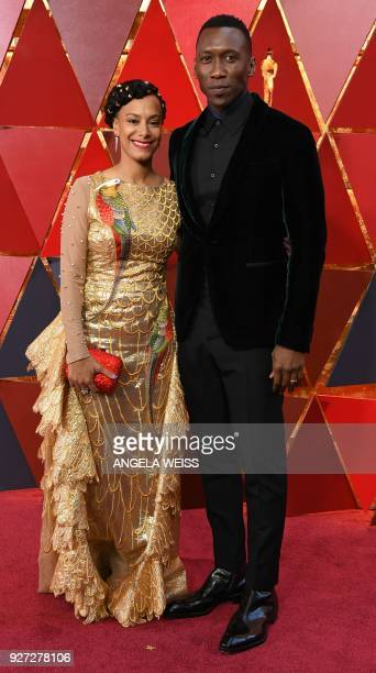 US actor Mahershala Ali and his wife Amatus SamiKarim arrive for the 90th Annual Academy Awards on March 4 in Hollywood California / AFP PHOTO /...