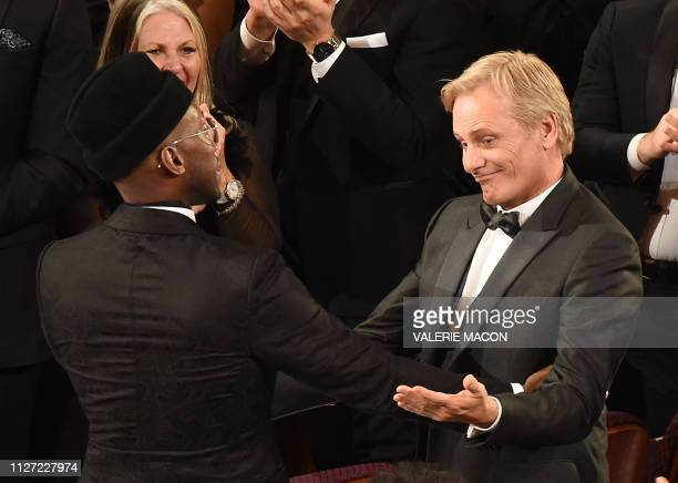 TOPSHOT US actor Mahershala Ali and US actor Viggo Mortensen celebrate the award for Best Picture for the movie Green Book during the 91st Annual...