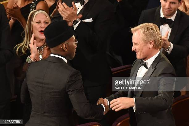US actor Mahershala Ali and US actor Viggo Mortensen shake hands after the movie Green Book won the Best picture award during the 91st Annual Academy...