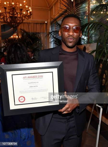 Actor Mahershala Ali poses with an award during the 19th Annual AFI Awards at Four Seasons Hotel Los Angeles at Beverly Hills on January 4 2019 in...