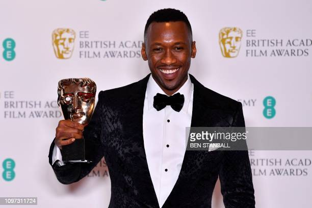 US actor Mahershala Ali poses with the award for a Supporting Actor for his work on the film 'Green Book' at the BAFTA British Academy Film Awards at...