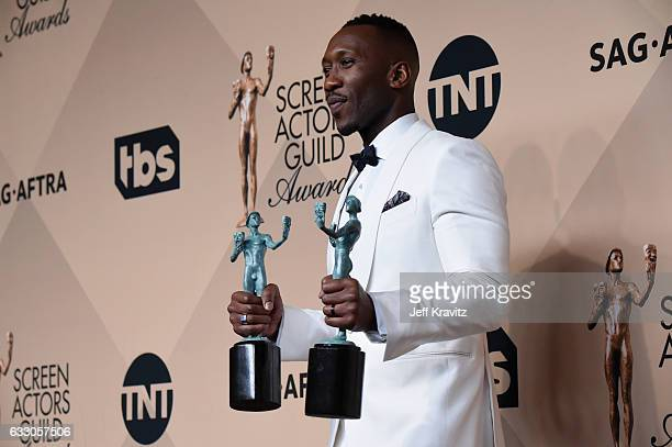 Actor Mahershala Ali, winner of the Outstanding Performance by a Male Actor in a Supporting Role award for 'Moonlight' and Outstanding Performance by...