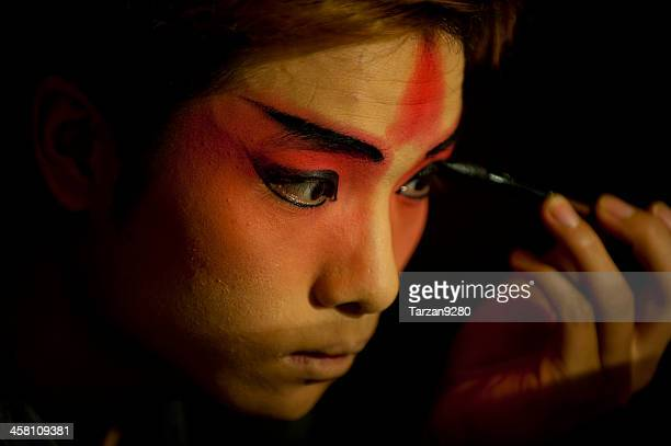 actor making up at back stage - peking opera stock photos and pictures