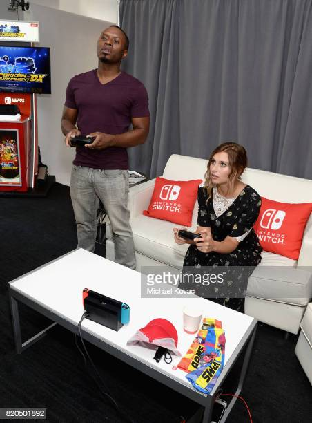Actor Malcolm Goodwin and actress Aly Michalka from the television series 'iZombie' stopped by Nintendo at the TV Insider Lounge to check out...