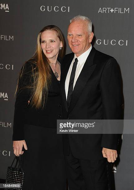 Actor Malcolm McDowell and Kelley Kuhr arrive at LACMA 2012 Art + Film Gala at LACMA on October 27, 2012 in Los Angeles, California.